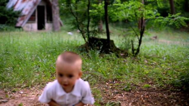 cute baby boy walking in spring forest