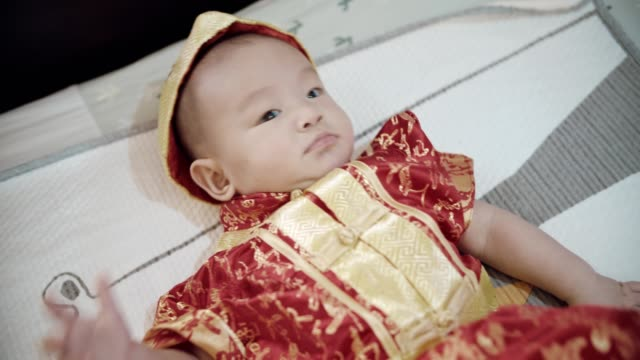cute baby boy(2-5 months) wearing traditional clothing for chinese new year festival - baby clothing stock videos & royalty-free footage