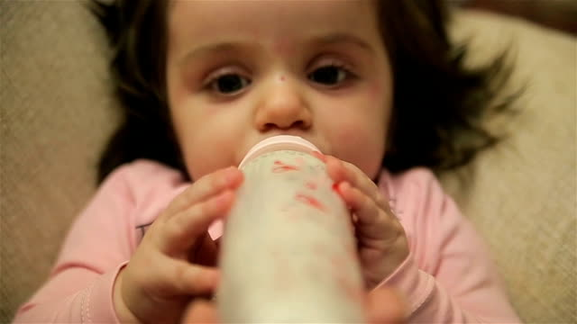 Cute baby drinking milk