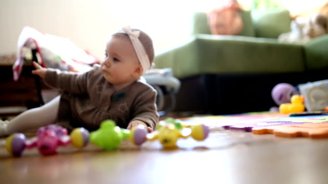 cute baby girl crawling in living room - crawling stock videos & royalty-free footage