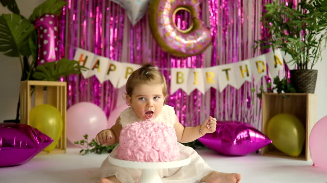 cute baby girl eating cake for his 1st birthday - number 1 stock videos & royalty-free footage