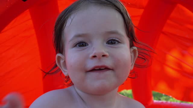 cute baby girl enjoying the day in a swimming pool having fun - babies only stock videos & royalty-free footage