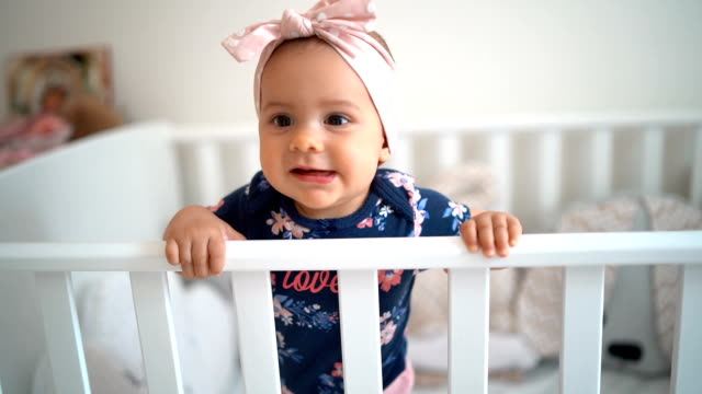 cute baby girl in the crib - one baby girl only stock videos & royalty-free footage
