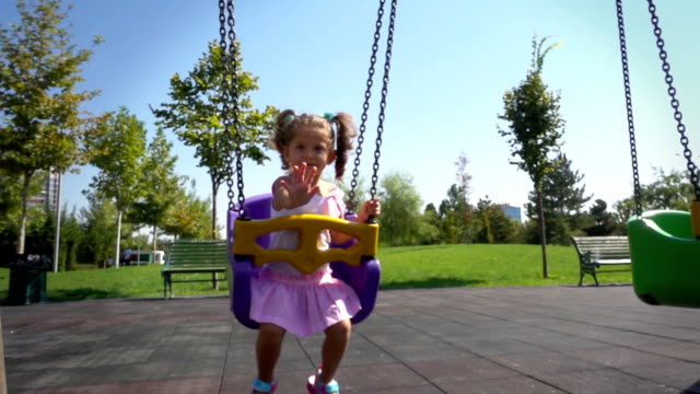 cute baby girl on swing - swinging stock videos & royalty-free footage