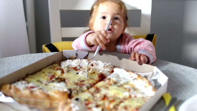 cute baby girl seeing pizza for the fist time and feeding her mother - small stock videos and b-roll footage