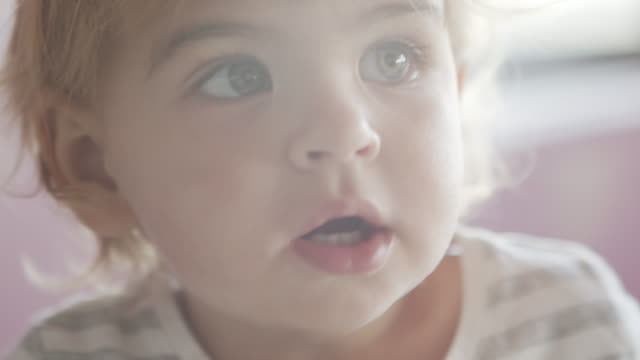 cu cute baby smiling - looking at camera video stock e b–roll