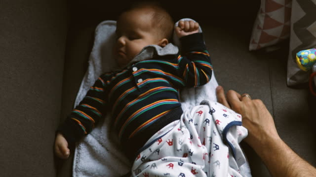 cute baby stretching in his sleep - single father stock videos & royalty-free footage