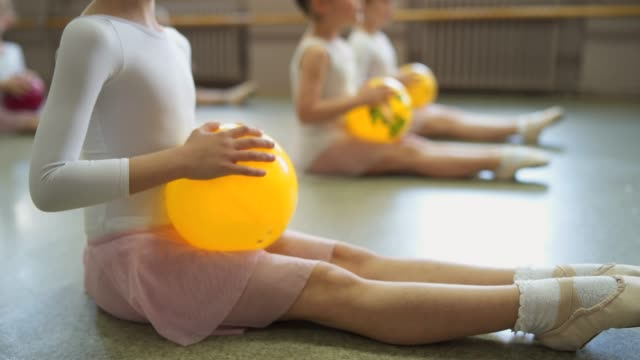 cute ballerinas stretching before ballet class - dance studio stock videos & royalty-free footage