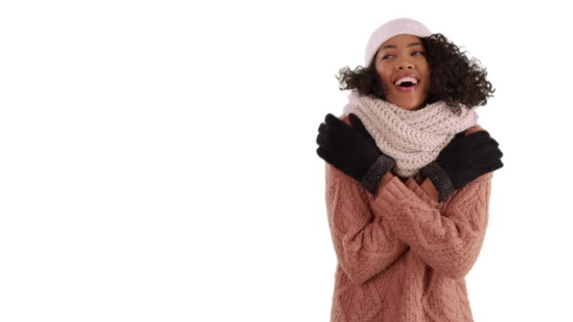 cute black female in cozy sweater trying to warm up in studio with copyspace - warm clothing stock videos & royalty-free footage