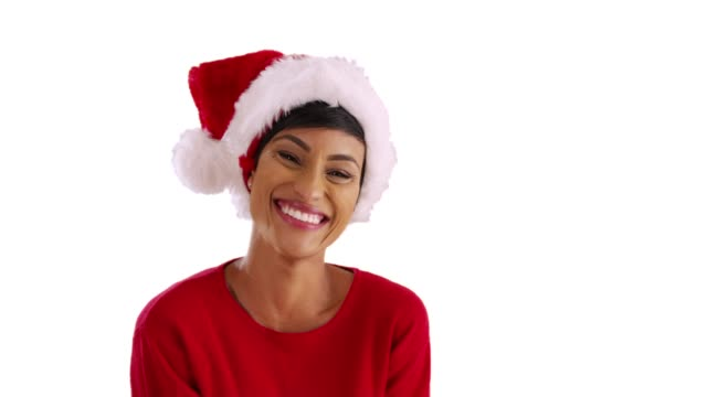 cute black female playing with festive santa hat in studio with copyspace - santa hat stock videos & royalty-free footage