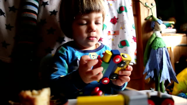 Cute Blond Boy Playing With Train Toy