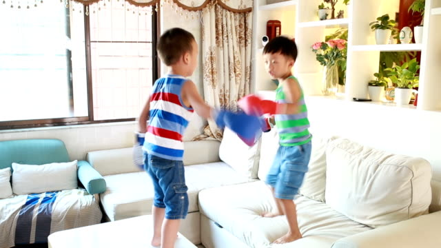 cute boy boxing - sibling stock videos and b-roll footage