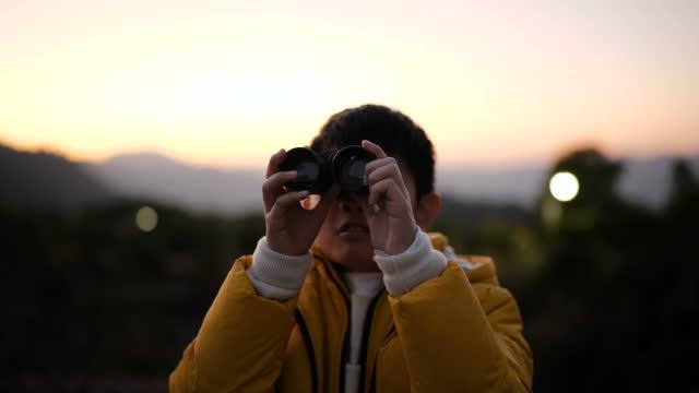 cute boy looking scenery with binoculars - binoculars stock videos & royalty-free footage