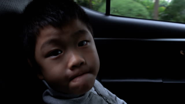 cute boy making a face in car - land vehicle stock videos & royalty-free footage