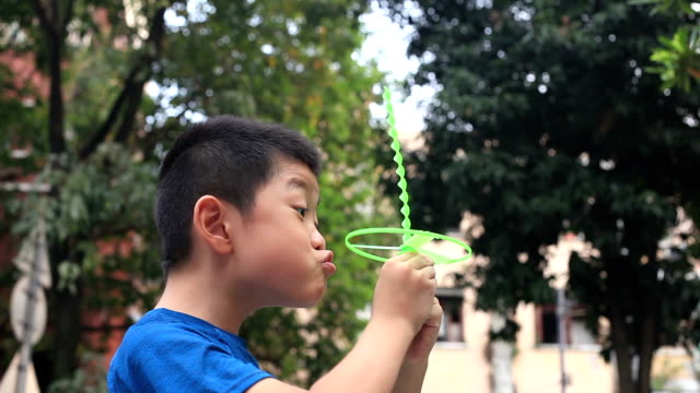 cute boy playing flying saucer - saucer stock videos and b-roll footage