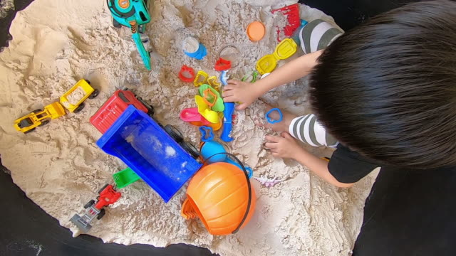 cute boy playing toy in sand playground - 2 kid in a sandbox stock videos and b-roll footage
