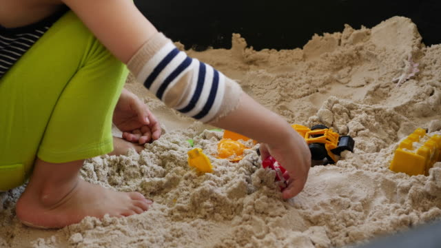cute boy playing toy in sandbox - 2 kid in a sandbox stock videos and b-roll footage