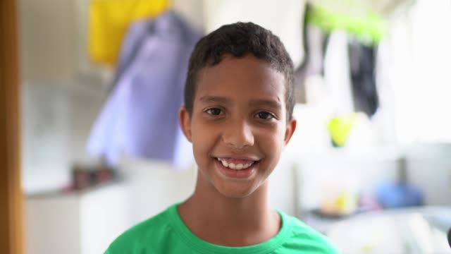 cute boy portrait at laundry - adoption stock videos & royalty-free footage