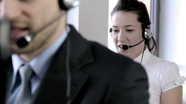 vídeos de stock, filmes e b-roll de cute business customer service woman smiling - coleira de pescoço de cachorro