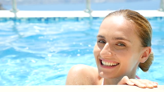 cute & charming woman at pool - at the edge of stock videos and b-roll footage