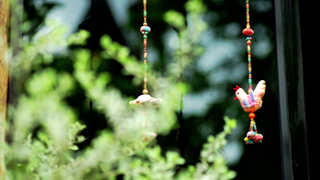 Cute chicken hanging mobile decorated in front of the terrace.