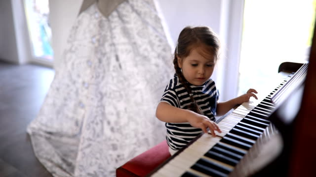 cute child at home playing a piano - domestic room stock videos & royalty-free footage