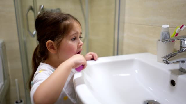 cute child brushing teeth - routine stock videos & royalty-free footage