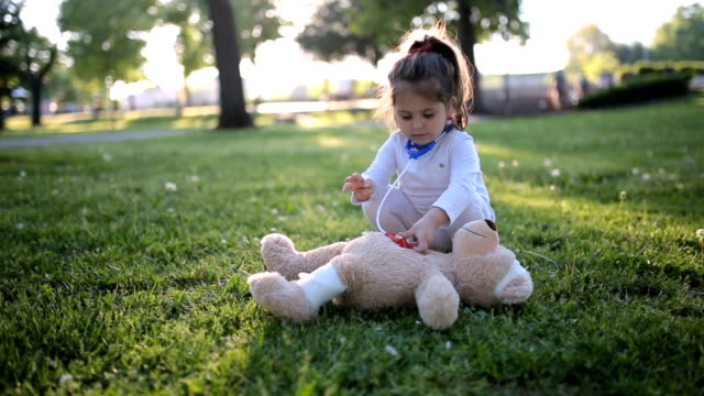 cute child doctor saving her teddy bear friend - medical equipment stock videos & royalty-free footage