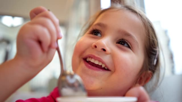 cute child eating pudding at home - snack stock videos & royalty-free footage