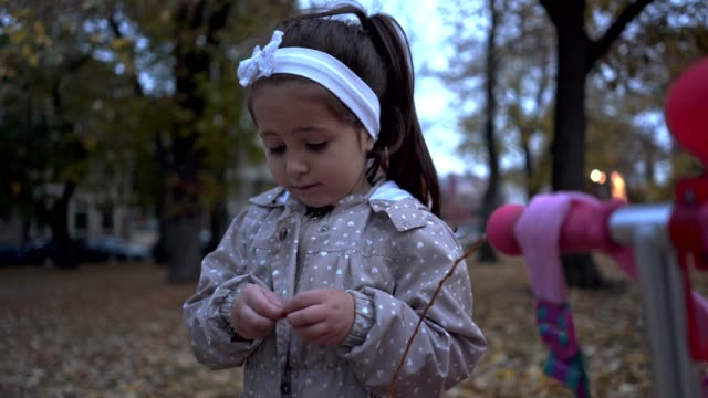 cute child playing in the park - ribbon sewing item stock videos & royalty-free footage