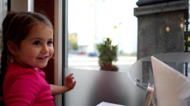 Cute child spending time playing at a cafe