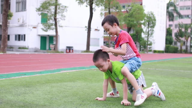 cute children playing in the park - brother stock videos & royalty-free footage