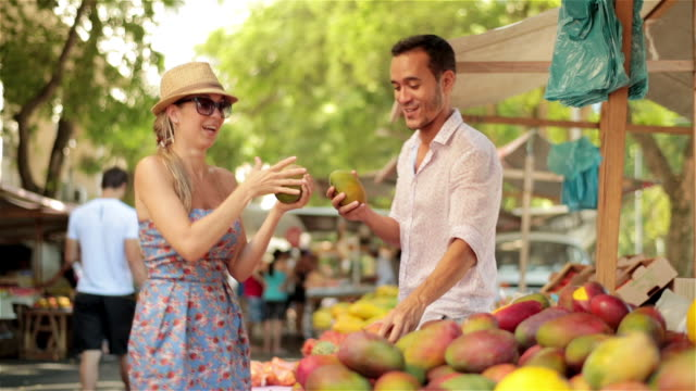 cute couple dance and drum with papayas in brazilian marketplace - maraca stock videos & royalty-free footage