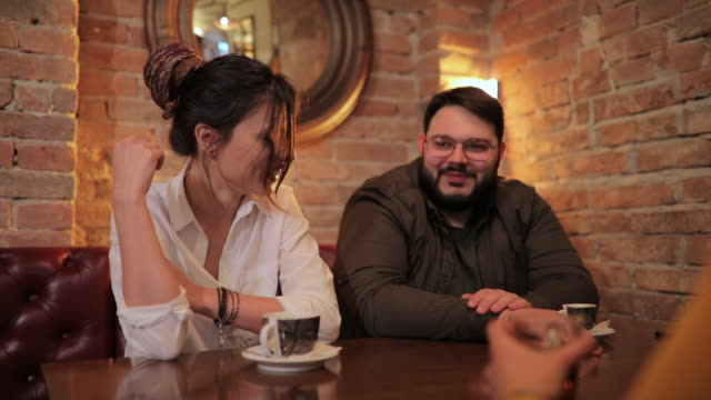cute couple sitting in cafe - overweight stock videos & royalty-free footage