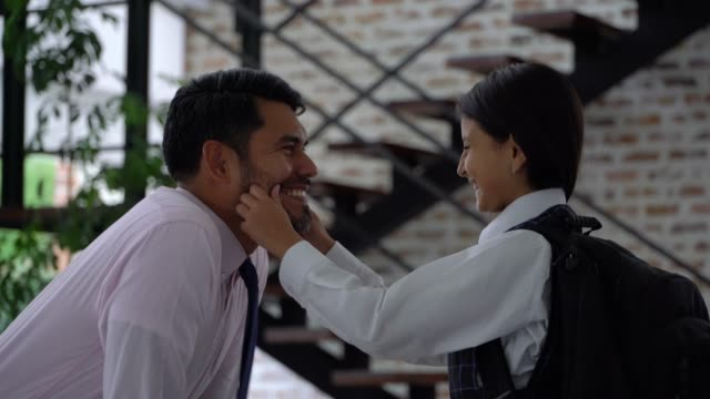 cute daughter checking her daddy's necktie and then grabbing his cheeks very lovingly - school uniform stock videos & royalty-free footage