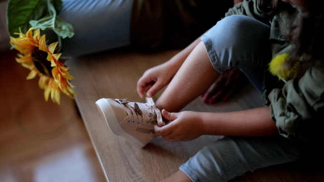 cute fashionable girl tying her shoes - tie stock videos & royalty-free footage
