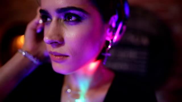 cute female dj having fun playing music at party club - club dj stock videos & royalty-free footage