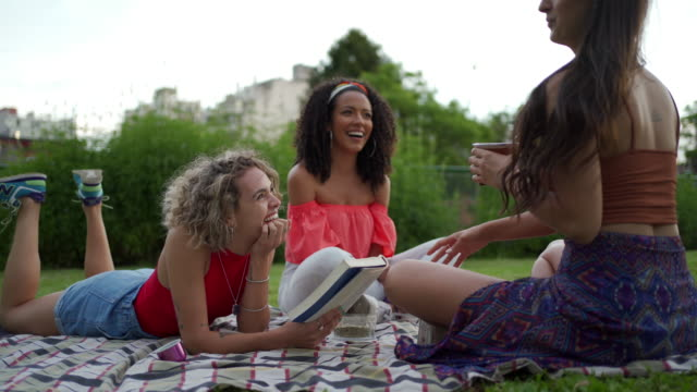 cute friends enjoying a picnic outdoors in a city park - fashionable stock videos & royalty-free footage