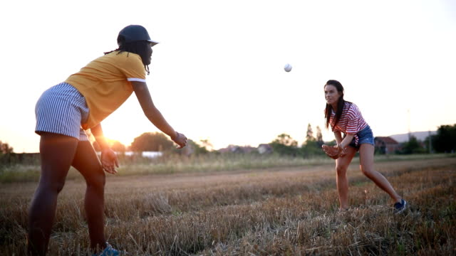 cute friends playing baseball together outdoors - baseball sport stock videos & royalty-free footage