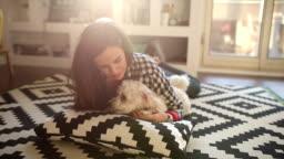 cute girl cuddling her dog