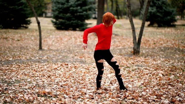 cute girl dancing in public park - autumn stock videos & royalty-free footage