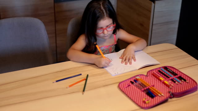 cute girl drawing in a note pad - one girl only stock videos & royalty-free footage