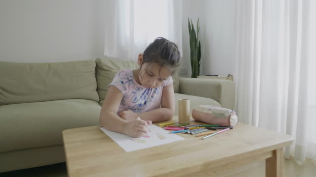 cute girl drawing in coloring page - art class stock videos & royalty-free footage