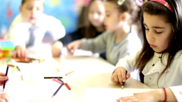 cute girl drawing in the classroom - school child stock videos & royalty-free footage