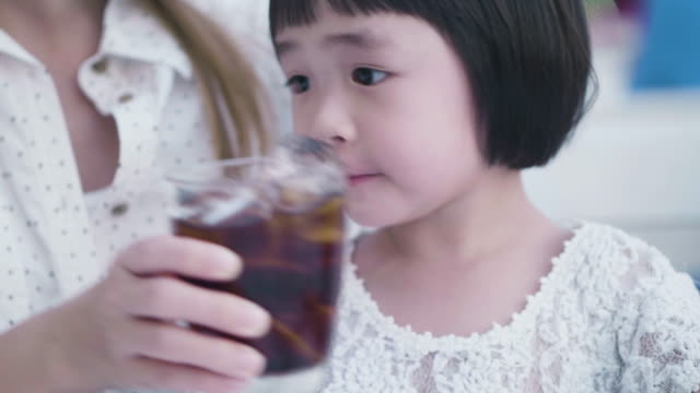 cute girl drinking cola soda - brown stock videos & royalty-free footage