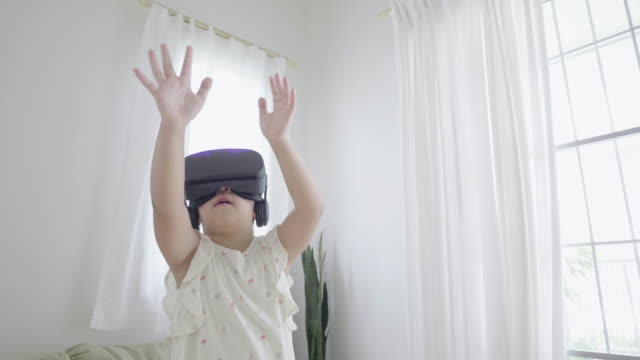 cute girl experiencing virtual reality - eyewear stock videos & royalty-free footage