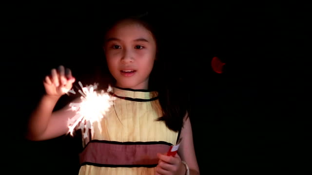 cute girl holding sparkler - little girls flashing stock videos and b-roll footage