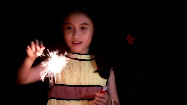 Cute girl Holding sparkler