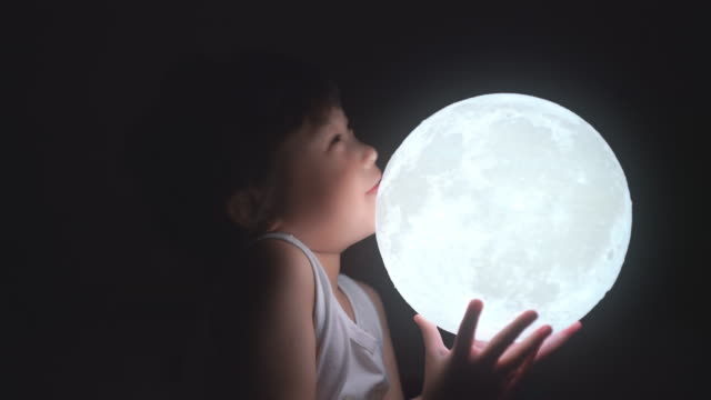 cute girl holding the moon at night - astronomy telescope stock videos & royalty-free footage