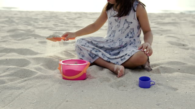 cute girl is play and enjoy on the beach. - baby girls stock videos & royalty-free footage